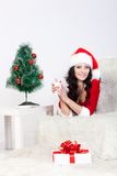 Woman wearing santa helper costume laying Royalty Free Stock Image