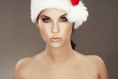 Woman wearing santas hat Stock Photography