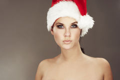 Woman wearing santas hat Stock Photo