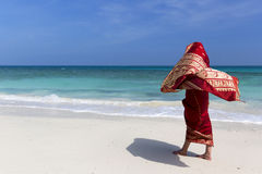 Woman wearing a sari on paradise beach. Stock Image