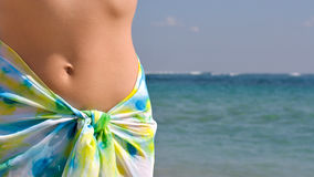 Woman wearing sarong by ocean Stock Photos