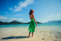 Woman wearing sarong on tropical beach Stock Image