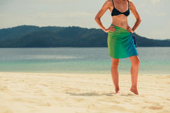 Woman wearing sarong on tropical beach Royalty Free Stock Images
