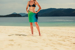 Woman wearing sarong on tropical beach Royalty Free Stock Image