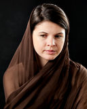 Woman wearing scarf on black Stock Photos