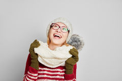 Woman wearing a scarf and a cap looking up Royalty Free Stock Photography
