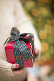 Woman Wearing Seasonal Red Mittens Holding Christmas Gift Royalty Free Stock Photo