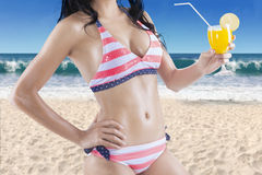 Woman wearing sexy bikini with fresh drink Stock Image