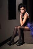 Woman wearing sexy purple dress Royalty Free Stock Photos