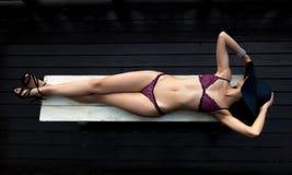 Woman wearing purple lingerie Stock Photography