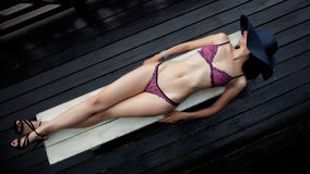 Woman wearing purple lingerie Royalty Free Stock Images