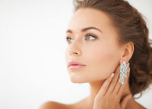 Woman Wearing Shiny Diamond Earrings Royalty Free Stock Photos