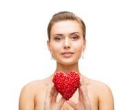 Woman wearing shiny diamond earrings Royalty Free Stock Image