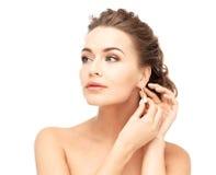 Woman wearing shiny diamond earrings Royalty Free Stock Photo