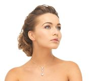 Woman wearing shiny diamond necklace. Close-up of beautiful woman wearing shiny diamond necklace Royalty Free Stock Photo