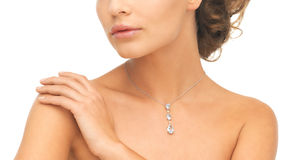 Woman wearing shiny diamond necklace Stock Images