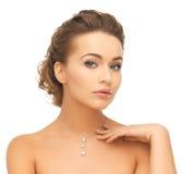 Woman wearing shiny diamond pendant. Beauty and jewelry concept - woman wearing shiny diamond pendant Royalty Free Stock Photos