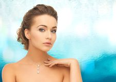 Woman wearing shiny diamond pendant Stock Photos