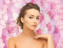 Woman wearing shiny diamond pendant Royalty Free Stock Photography