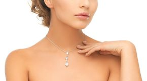 Woman wearing shiny diamond pendant Royalty Free Stock Image
