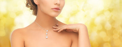 Woman wearing shiny diamond pendant Stock Photo