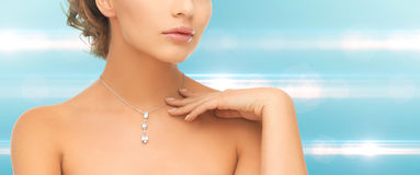 Woman wearing shiny diamond pendant Royalty Free Stock Photography