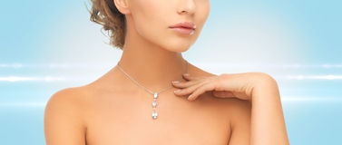 Woman wearing shiny diamond pendant Stock Image