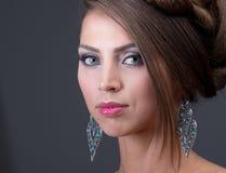 Woman wearing shiny silver earring Stock Photo