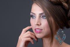 Woman wearing shiny silver earring Royalty Free Stock Photo