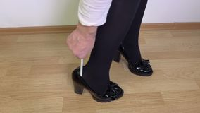 Woman wearing shoes in the room stock footage