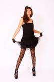 Woman wearing short black dress Stock Photo