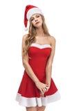 Woman wearing a short santa claus clostume Royalty Free Stock Images