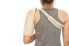 Woman wearing a shoulder brace. Isolate stock photography
