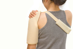 Woman wearing a shoulder brace. Isolate royalty free stock photo