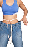 Woman wearing and showing off an oversized denim jeans Royalty Free Stock Photos