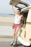 Woman Wearing Skates By Campervan Royalty Free Stock Images