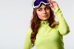 Woman wearing ski goggles Stock Photo