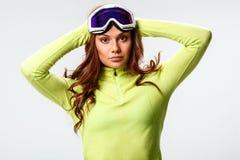 Woman wearing ski goggles Stock Photos