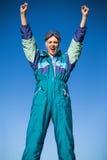 Woman wearing ski suit cheering Royalty Free Stock Photos