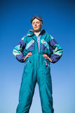 Woman wearing ski suit with closed eyes Royalty Free Stock Images