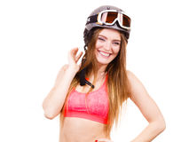 Woman wearing ski suit and helmet with goggles Stock Image