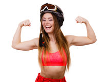 Woman wearing ski suit, helmet with goggles showing muscles Stock Photography
