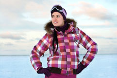 Woman wearing skiing suit posing outdoors Royalty Free Stock Image