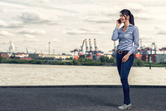 Woman wearing skinny jeans while talking on phone Stock Image