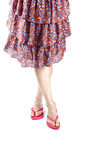 Woman Wearing Skirt and Red Flip Flops. Woman floral skirt and Red flip flops isolated on white stock image