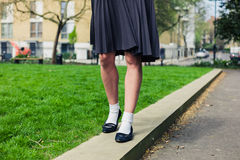 Woman wearing a skirt walking in park Royalty Free Stock Images