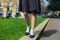 Woman wearing a skirt walking in park Royalty Free Stock Image