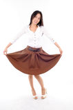 Woman wearing a skirt on white background Royalty Free Stock Photography