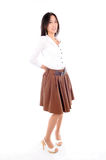 Woman wearing a skirt on white background Stock Photo