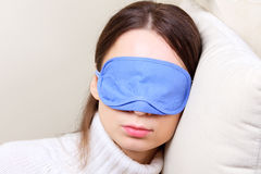 Woman wearing sleep mask Stock Photos